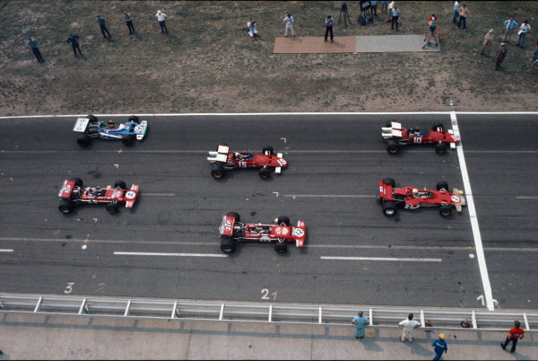 Hockenheim, Germany. 31st July - 2nd August 1970.  Front three rows of the grid with Jacky Ickx, Ferrari 312B, on pole from Jochen Rindt, Lotus 72C Ford, Clay Regazzoni, Ferrari 312B, Jo Siffert, March 701 Ford, Henri Pescarolo, Matra MS120, and Chris Amon, March 701 Ford.  Ref: 70GER15. World Copyright: LAT Photographic