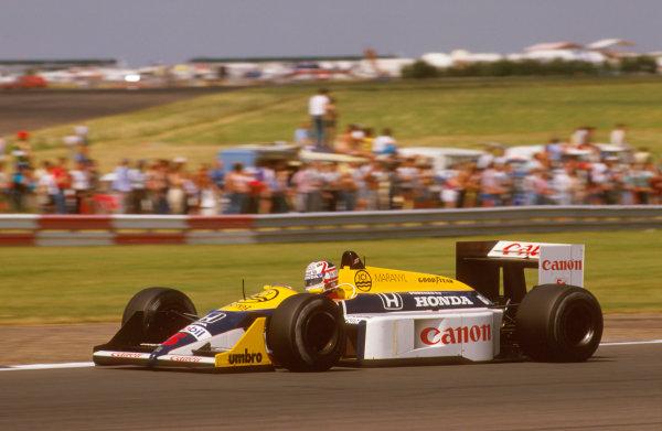 1987 British Grand Prix. Silverstone, England. 10-12 July 1987. Nigel Mansell (Williams FW11B Honda) 1st position. Ref-87 GB 28. World Copyright - LAT Photographic