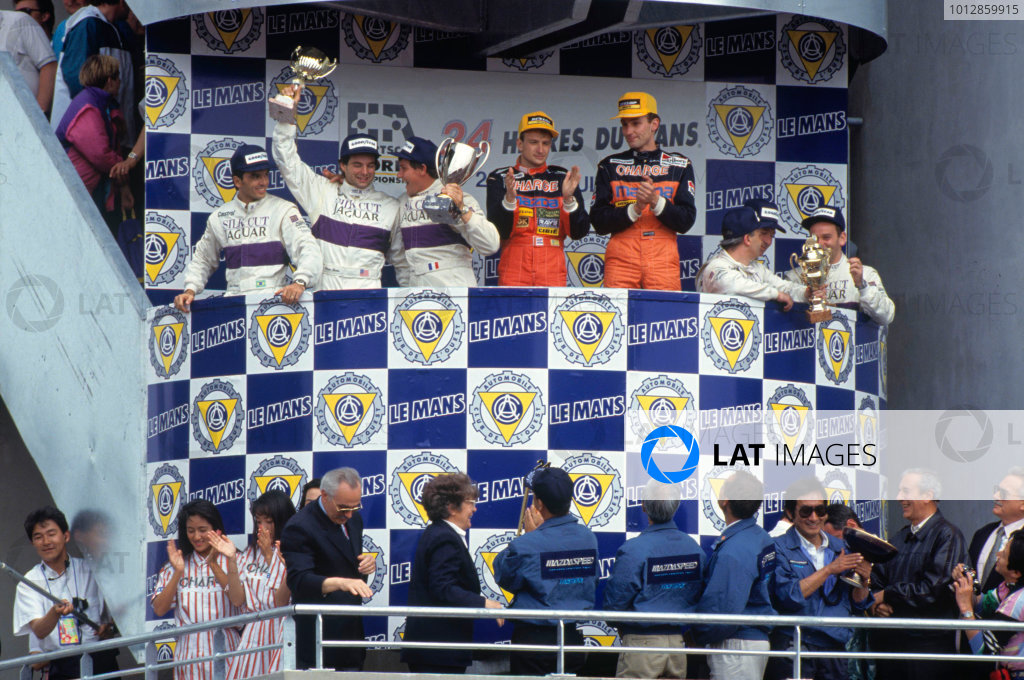 1991 Le Mans 24 hours. Le Mans, France. 22-23 June 1991. Volker Weidler/Bertrand Gachot (Mazda 787B), 1st position, on the podium with Raul Boesel/Michel Ferte/Davy Jones (Jaguar XJR-12), 2nd position, and Kenny Acheson/Teo Fabi/Bob Wollek (Jaguar XJR-12), 3rd position. World Copyright - LAT Photographic. Ref: 91LM09