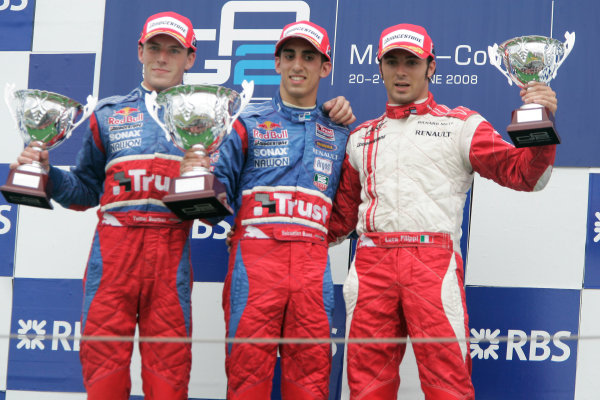 Magny-Cours, France. 22nd June.Sunday Race. Sebastien Buemi (SUI, Trust Team Arden) celebrates his victory on the podium with Yelmer Buurman (NED, Trust Team Arden) and Luca Filippi (ITA, ART Grand Prix). World Copyright: Alastair Staley/GP2 Series Media Service.ref: Digital Image _MG_3558