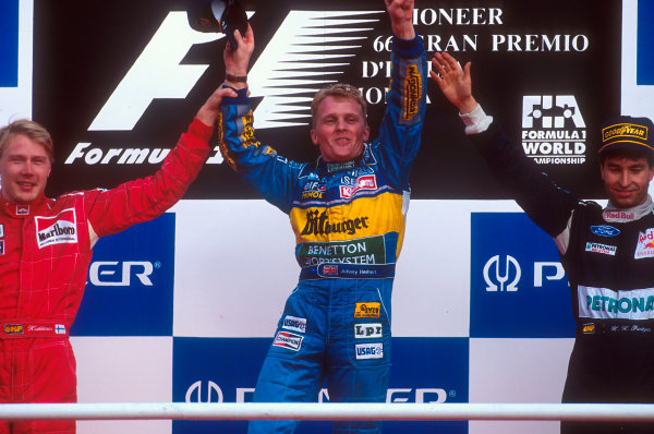 Monza, Italy.8-10 September 1995.Johnny Herbert (Benetton Renault) 1st position, Mika Hakkinen (McLaren Mercedes) 2nd position and Heinz-Harald Frentzen (Sauber Ford) 3rd position on the podium.Ref-95 ITA 07.World Copyright - LAT Photographic