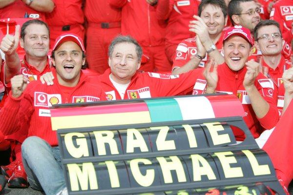 2006 Brazilian Grand Prix - Sunday Race Interlagos, Sao Paulo, Brazil. 19th - 22nd October 2006. The Ferrari team say goodbye and thank you to Michael Schumacher after the 7 times World Champion retires, portrait. World Copyright: Lorenzo Bellanca/LAT Photographic ref: Digital Image MU4Z4394
