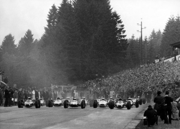 1965 Belgian Grand Prix.Spa-Francorchamps, Belgium.11-13 June 1965.Graham Hill (BRM P261) Jim Clark (Lotus 25), Jackie Stewart (BRM P261), Richie Ginther (Honda RA272), Jo Siffert (Brabham BT11 BRM), at the front of the grid at the start, action.World Copyright - LAT Photographic.Ref: B/W Print.
