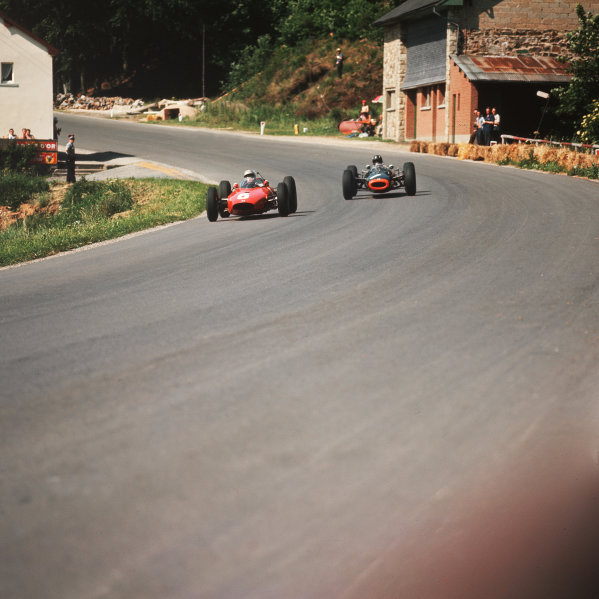 Spa-Francorchamps, Belgium.12-14 June 1964.  Giancarlo Baghetti (number 6, BRM P57) and Graham Hill (BRM P261) at Burnenville.  Ref-3/1248.World Copyright - LAT Photographic