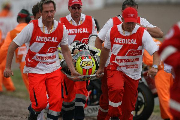 Germany Sachsenring 16-18 July 2010Lucas Pesek is stretchered away after his first corner Moto2 crash