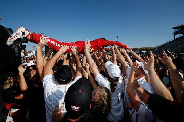 28-30 August, 2015, Sonoma, California, USA Champion Scott Dixon goes crowd surfing on a mosh pit of team guests © 2015, Michael L. Levitt LAT Photo USA