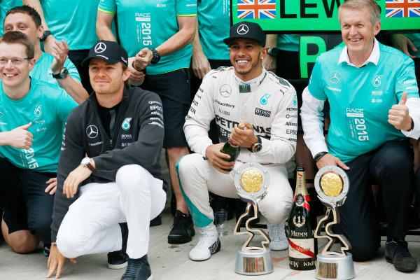 Sochi Autodrom, Sochi, Russia. Sunday 11 October 2015. Nico Rosberg, Mercedes AMG, and Lewis Hamilton, Mercedes AMG, 1st Position, celebrate with the Mercedes team. World Copyright: Alastair Staley/LAT Photographic. ref: Digital Image _79P1519