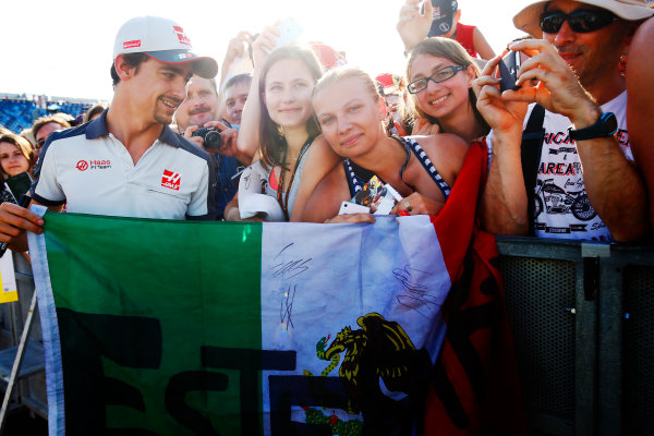 Hungaroring, Budapest, Hungary. Thursday 21 July 2016. Esteban Gutierrez, Haas F1 poses fora  picture with fans. World Copyright: Andrew Hone/LAT Photographic ref: Digital Image _ONZ0635
