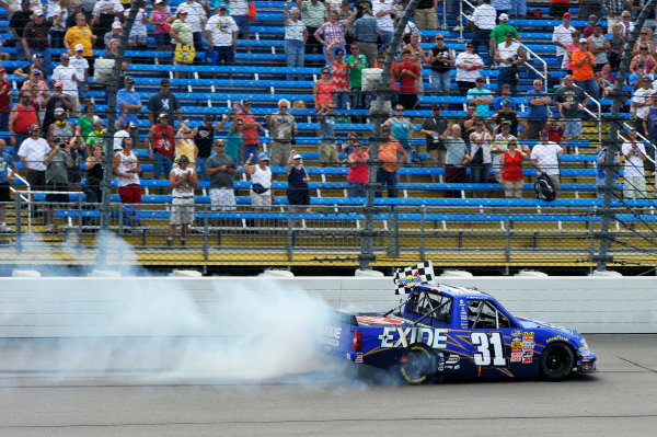 7-8 September, 2013, Newton, Iowa USA James Buescher celebrates the win with a burn out ©2013, Scott R LePage LAT Photo USA