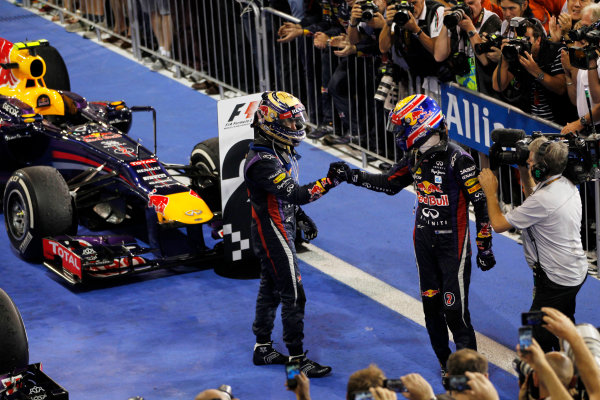 Yas Marina Circuit, Abu Dhabi, United Arab Emirates. Sunday 3rd November 2013. Sebastian Vettel, Red Bull Racing, 1st position, and Mark Webber, Red Bull Racing, 2nd position, celebrate in Parc Ferme. World Copyright: Jed Leicester/LAT Photographic. ref: Digital Image _JEL6417