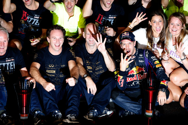 Buddh International Circuit, New Delhi, India. Sunday 27th October 2013. Christian Horner, Team Principal, Red Bull Racing, Adrian Newey, Chief Technical Officer, Red Bull Racing, Sebastian Vettel, Red Bull Racing, 1st position, and the Red Bull team celebrate overall 2013 World Championship victory. World Copyright: Glenn Dunbar/LAT Photographic. ref: Digital Image _89P9270