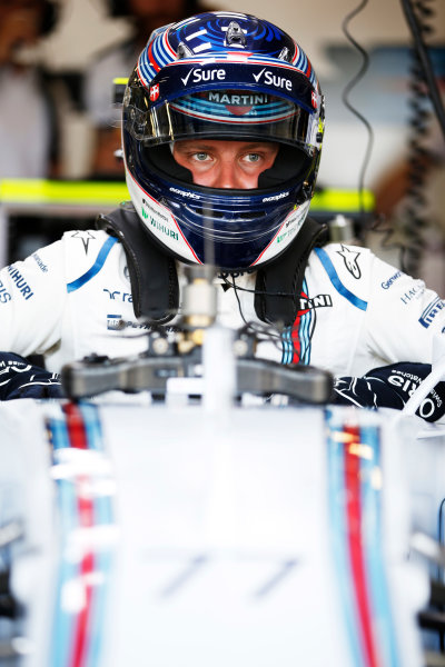 Silverstone, Northamptonshire, England. Friday 03 July 2015. Valtteri Bottas, Williams FW37 Mercedes climbs into his car. World Copyright: Glenn Dunbar/LAT Photographic. ref: Digital Image _89P0877