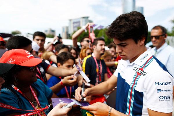 Baku City Circuit, Baku, Azerbaijan. Friday 23 June 2017. Lance Stroll, Williams Martini Racing, signs autographs for fans. World Copyright: Glenn Dunbar/LAT Images ref: Digital Image _X4I0500