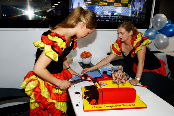 Hungaroring, Budapest, Hungary.  Saturday 29 July 2017. Ladies dressed as Flamenco dancers cut up the cake for Fernando Alonso, McLaren, on his birthday. World Copyright: Steven Tee/LAT Images  ref: Digital Image _R3I3659