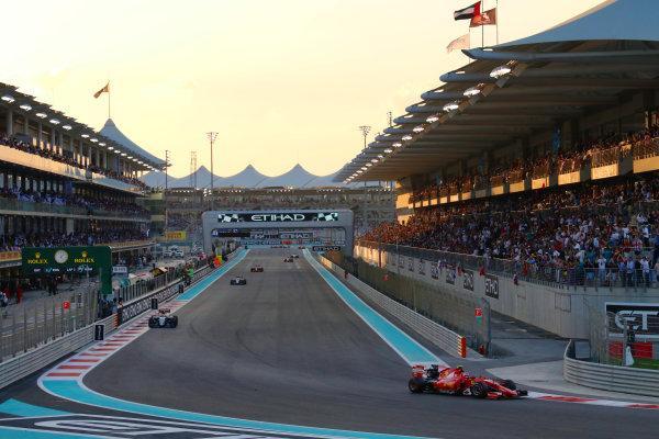 Yas Marina Circuit, Abu Dhabi, United Arab Emirates. Sunday 29 November 2015. Kimi Raikkonen, Ferrari SF-15T, leads Sergio Perez, Force India VJM08 Mercedes. World Copyright: Will Taylor-Medhurst/LAT Photographic ref: Digital Image 267A0022