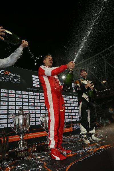 2015 Race Of Champions Olympic Stadium, London, UK Saturday 21 November 2015 Sebastian Vettel (GER) and Petter Solberg (NOR) celebrate on the podium Copyright Free FOR EDITORIAL USE ONLY. Mandatory Credit: 'IMP'