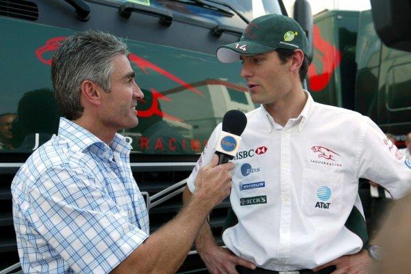 (L to R): Mick Doohan (AUS) and Mark Webber (AUS) Jaguar. Formula One World Championship, Rd12, German Grand Prix, Hockenheim, Germany, 1 August 2003. DIGITAL IMAGE