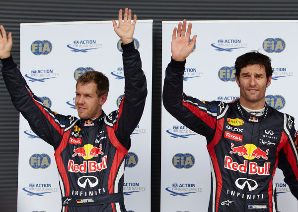 Silverstone, Northamptonshire, England 9th July 2011 Pole man Mark Webber, Red Bull Racing RB7 Renault, with front row starter and team mate Sebastian Vettel, Red Bull Racing RB7 Renault. Portrait.  World Copyright: Steve Etherington/LAT Photographic ref: Digital Image SNE22272