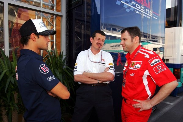 (L to R): Vitantonio Liuzzi (ITA) Red Bull Racing talks with Guenther Steiner (ITA) Red Bull Racing Technical Director and Stefano Domenicali (ITA) Ferrari Manager of F1 Operations.