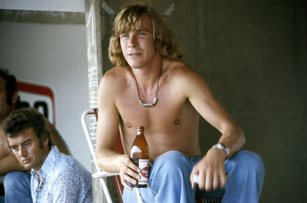 James Hunt, with a beer and cigarettes in the pits.