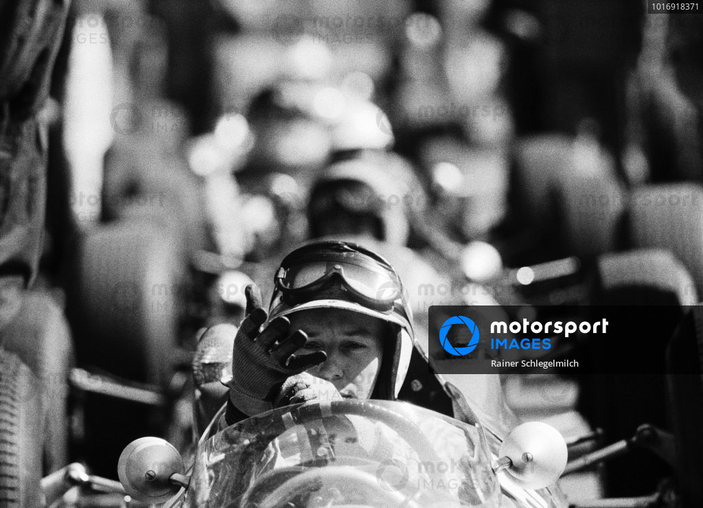 John Surtees, Ferrari 158, pulls on his gloves.
