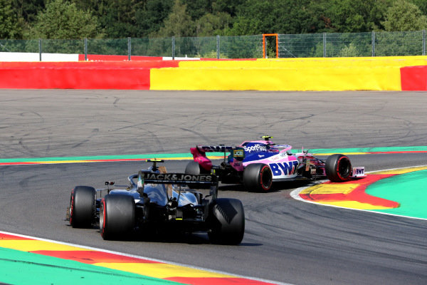 Lance Stroll, Racing Point RP19, leads Kevin Magnussen, Haas VF-19