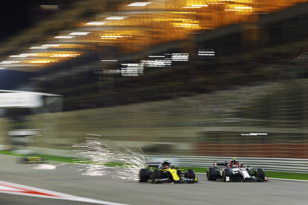 Antonio Giovinazzi, Alfa Romeo Racing C39, battles with Esteban Ocon, Renault R.S.20, as sparks fly