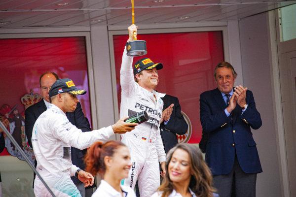 Nico Rosberg, 1st position, celebrates on the podium beside Lewis Hamilton, 2nd position.