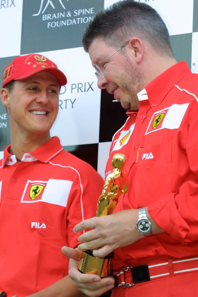 2002 American Grand Prix - Friday PracticeIndianapolis, USA. 27th September 2002The Bernie awards: Michael Schumacher and Ross Brawn.World Copyright - LAT Photographicref: Digital File Only
