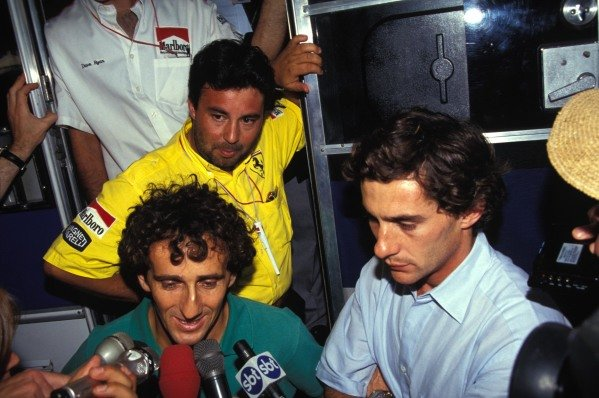 Alain Prost and Ayrton Senna speak to the media.