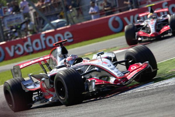 Fernando Alonso, McLaren MP4-22 Mercedes leads Lewis Hamilton, McLaren MP4-22 Mercedes.