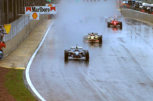 Interlagos, Brazil.29-31 March 1996.Damon Hill (Williams FW18 Renault) leads Rubens Barrichello (Jordan 196 Peugeot) and Michael Schumacher (Ferrari F310).Ref-96 BRA 11.World Copyright - LAT Photographic