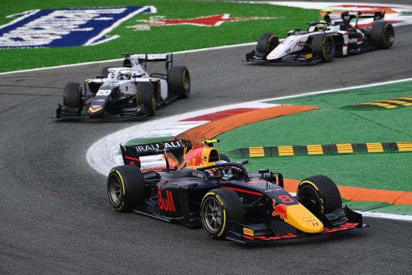 Juri Vips (EST, Hitech Grand Prix), leads Matteo Nannini (ITA, Campos Racing)