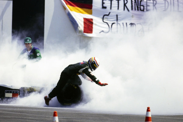 Alessandro Zanardi falls over after getting out of his Lotus 109 Mugen-Honda.