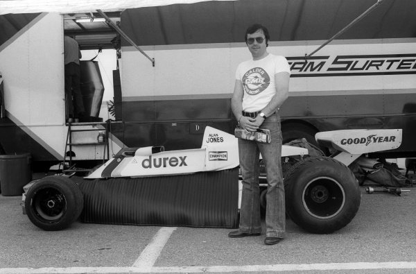 Thirteenth placed Alan Jones (AUS) stands with his Surtees TS19 in the paddock.Swedish Grand Prix, Rd 7, Anderstorp, Sweden, 13 June 1976.
