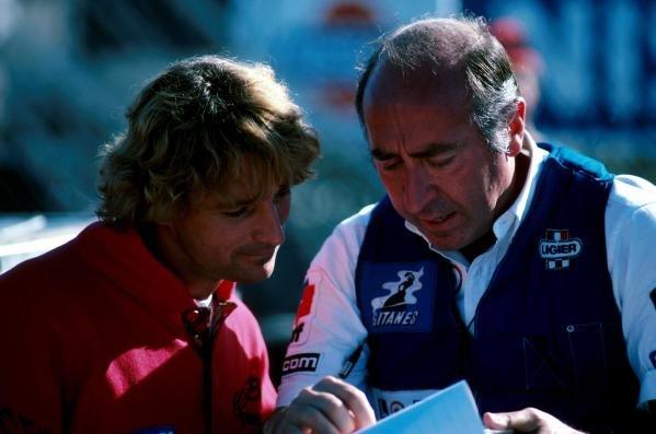 Rene Arnoux (FRA) (l) and Ligier engineerFormula One World Championship 1986