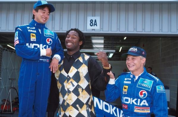 Ukyo Katayama, left and Mika Salo meet British Boxer Lennox Lewis. British Grand Prix, Silverstone, 16th July 1995