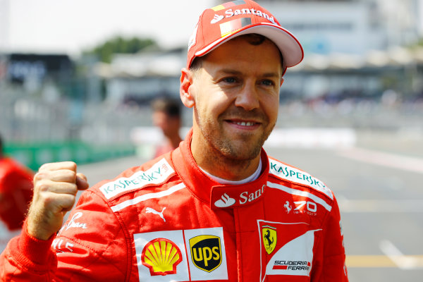 Autodromo Hermanos Rodriguez, Mexico City, Mexico. Saturday 28 October 2017. Sebastian Vettel, Ferrari, celebrates pole position. World Copyright: Steven Tee/LAT Images  ref: Digital Image _R3I5378
