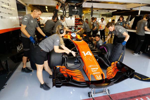 Yas Marina Circuit, Abu Dhabi, United Arab Emirates. Friday 24 November 2017. Fernando Alonso, McLaren MCL32 Honda, prepares to leave the garage. World Copyright: Steven Tee/LAT Images  ref: Digital Image _O3I0934