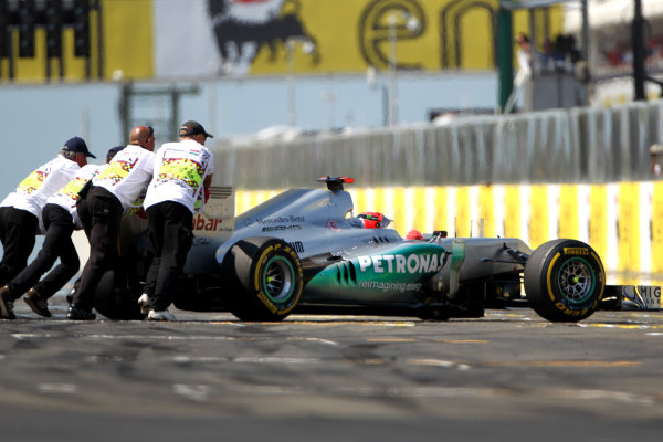Hungaroring, Budapest, Hungary29th July 2012Michael Schumacher, Mercedes F1 W03, is pushed off the grid with car trouble at the start.World Copyright:Andy Hone/LAT Photographicref: Digital Image HONY9974