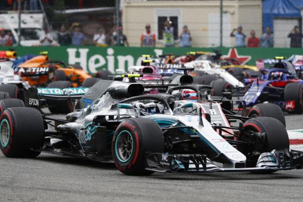 Valtteri Bottas, Mercedes AMG F1 W09, leads Romain Grosjean, Haas F1 Team VF-18 Ferrari.