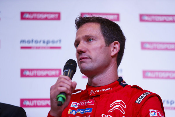 Colin Clark talks to the Citroen WRC team on the Autosport Stage.