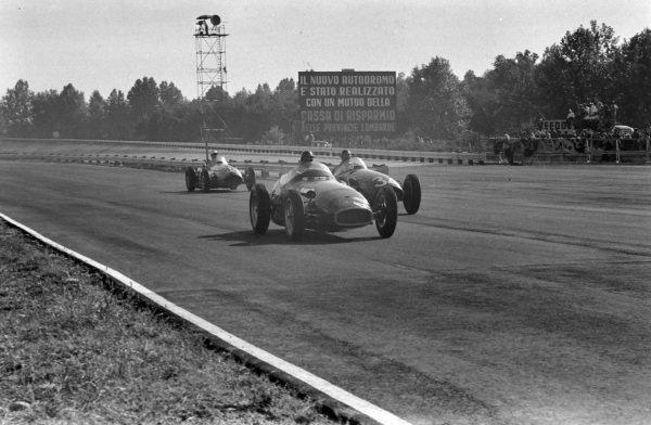Ken Wharton, Vanwall, leads Carlos Menditéguy, Maserati 250F, and John Fitch, Maserati 250F.