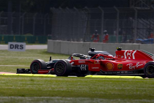 Lewis Hamilton, Mercedes AMG F1 W09 EQ Power+, passes Kimi Raikkonen, Ferrari SF71H