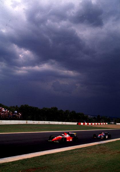 1993 South African Grand Prix.Kyalami, South Africa.12-14 March 1993.Gerhard Berger (Ferrari F93A) leads Rubens Barrichello (Jordan 193 Hart).World Copyright - LAT Photographic