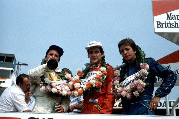 Calvin Fish, Ayrton Senna and Martin Brundle celebrate on the podium.