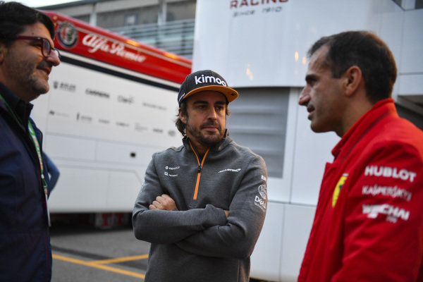 Fernando Alonso, McLaren, with Marc Gene, Ferrari