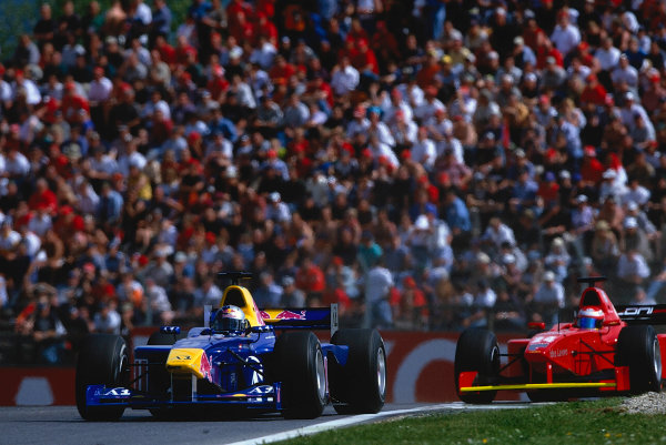 2002 F3000 ChampionshipA1-Ring, Austria. 11th May 2002.Patrick Friessacher (Red Bull Jnr), leads Enrico Toccacelo (Coloni F3000), action.World Copyright: Clive Rose/LAT Photographicref: 35mm Image A17