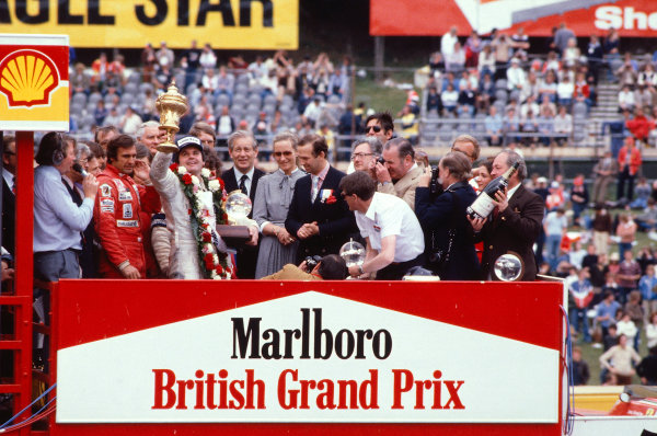 1980 British Grand Prix.Brands Hatch, England.11-13 July 1980.Alan Jones (Williams Ford) celebrates his 1st position on the podium. TRH Prince and Princess Michael of Kent stand to the right and Carlos Reutemann (Williams Ford) 3rd position and commentator Brian Jones to the left.Ref-80 GB 11.World Copyright - LAT Photographic