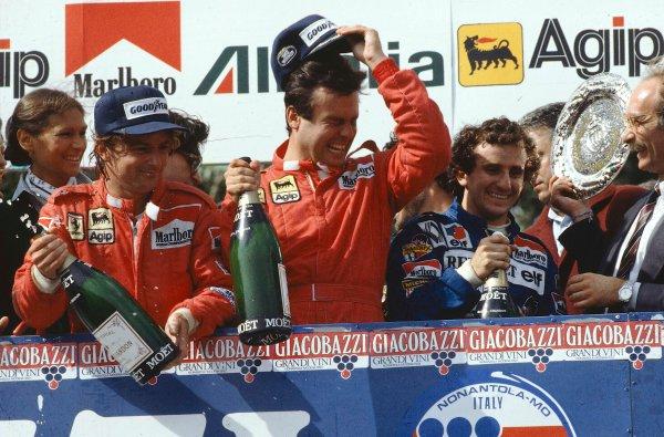 1983 San Marino Grand Prix.Imola, Italy.29/4-1/5 1983.Patrick Tambay (Ferrari) 1st position, Alain Prost (Equipe Renault) 2nd position and Rene Arnoux (Ferrari) 3rd position on the podium. Ref-83 SM 01.World Copyright - LAT Photographic